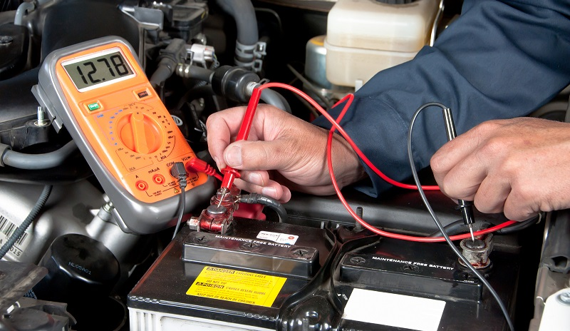 automotive repair center checking battery