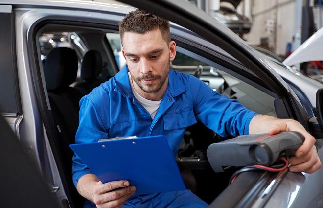 mechanic checks diagnostic tool